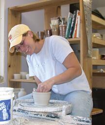 Mindy Knapik at the potter's wheel