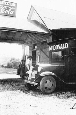 Herb McDonald in the early 1930s with huckster truck