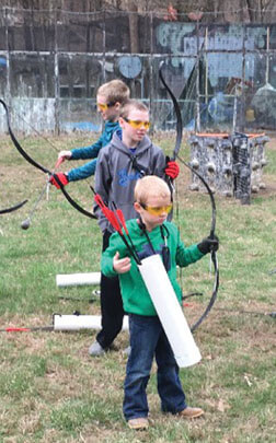 Kids enjoying Arrow Tag games during a family vacation