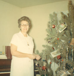 Sampler's mom by the tree in the 1960s